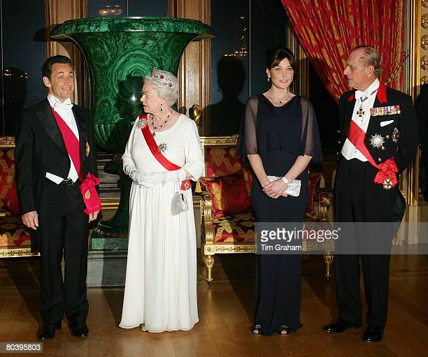 Queen Elizabeth II and Prince Philip, Duke of Edinburgh host a State Banquet for President Nicolas Sarkozy and his wife Carla Bruni-Sarkozy at...