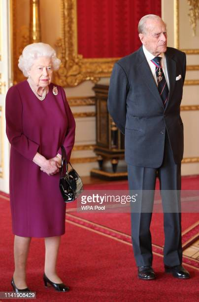 Queen Elizabeth II and Prince Philip, Duke of Edinburgh join members of the Order of Merit ahead of a luncheon at Windsor Castle on May 7, 2019 in...