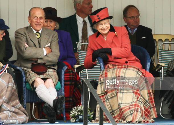 Queen Elizabeth II and Prince Philip, Duke of Edinburgh laugh as they watch the games during the Annual Braemar Highland Gathering on September 6,...