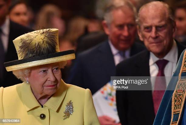 Queen Elizabeth II and Prince Philip Duke of Edinburgh leave after a Commonwealth Day Service at Westminster Abbey on March 13 2017 in London United...