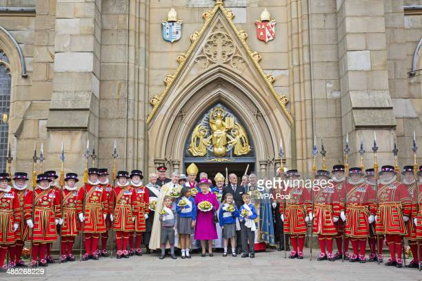 Queen Elizabeth II and Prince Philip Duke of Edinburgh leave Blackburn Cathedral after attending the Royal Maundy Service on April 17 2014 in...