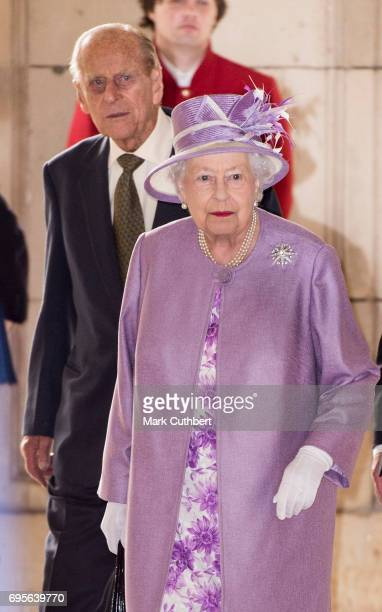 Queen Elizabeth II and Prince Philip Duke of Edinburgh leave after attending Evensong in celebration of the centenary of the Order of the Companions...