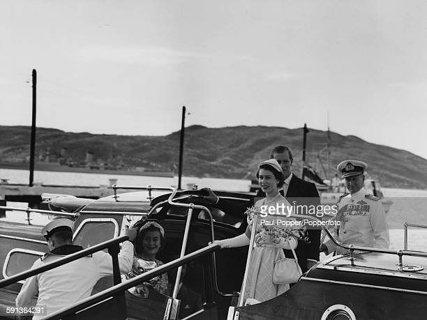 Queen Elizabeth II and Prince Philip Duke of Edinburgh leave Jamaica as they board the Admiral's barge to transport the royal couple to the SS Gothic...