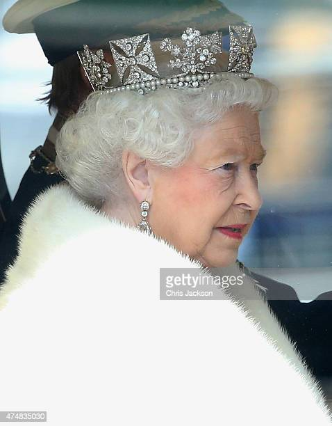 Queen Elizabeth II and Prince Philip Duke of Edinburgh leave Buckingham Palace in the Diamond Jubilee State Coach to travel to the Houses of...