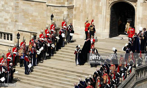 Queen Elizabeth II and Prince Philip, Duke of Edinburgh leave St George's Chapel at Windsor Castle after attending the annual Order of the Garter...