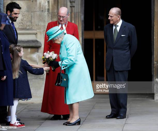 Queen Elizabeth II and Prince Philip Duke of Edinburgh leave the Easter Day service at St George's Chapel on April 16 2017 in Windsor England