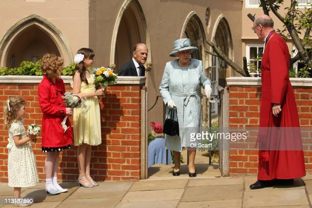 Queen Elizabeth II and Prince Philip, Duke of Edinburgh, leave the Deanery of St George's Chapel in Windsor Castle after attending the Easter Matins...
