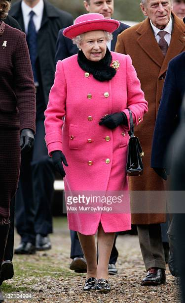 Queen Elizabeth II and Prince Philip Duke of Edinburgh leave the church of St Mary in Flitcham near the Sandringham Estate after attending Sunday...