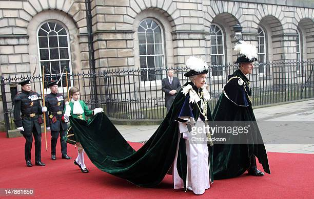 Queen Elizabeth II and Prince Philip Duke of Edinburgh leave the Signet Library to head to St Giles Cathederal for the Thistle Ceremony on July 5...