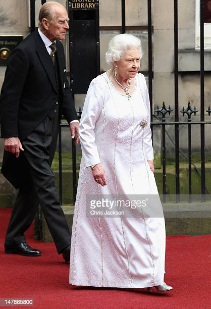 Queen Elizabeth II and Prince Philip Duke of Edinburgh leaves the Signet Library after lunch on July 5 2012 in Edinburgh Scotland Prince William Duke...