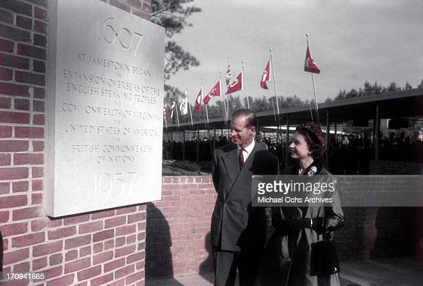Queen Elizabeth II and Prince Philip Duke of Edinburgh look at a plaque commerorating the 350th anniverasy of the founding of the Jamestown colony in...