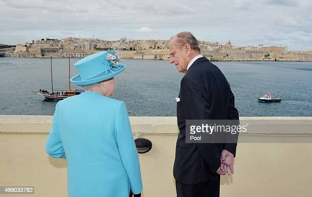 Queen Elizabeth II and Prince Philip Duke of Edinburgh look at the view from the Kalkara heritage site in Valletta Harbour on November 28 2015 in...