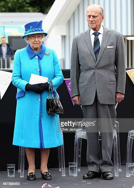Queen Elizabeth II and Prince Philip, Duke of Edinburgh look on at the opening of the Borders Railway at Tweedbank Station on September 9, 2015 in...