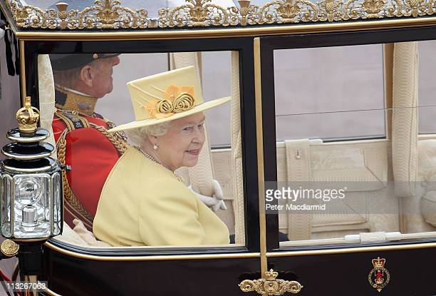 Queen Elizabeth II and Prince Philip Duke of Edinburgh make the journey by carriage procession to Buckingham Palace after the Royal Wedding of Prince...