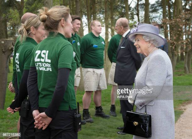 Queen Elizabeth II and Prince Philip Duke of Edinburgh meet zookeepers as they arrive to open the new Centre for Elephant Care at ZSL Whipsnade Zoo...