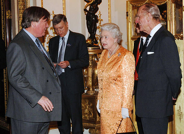 Queen Elizabeth II and Prince Philip Duke of Edinburgh meet former Chancellor Kenneth Clarke at a Buckingham Palace reception for backbench MPs on...