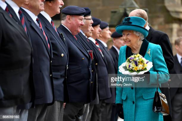 Queen Elizabeth II and Prince Philip Duke of Edinburgh meet former servicemen following the Royal Maundy service at Leicester Cathedral on April 13...