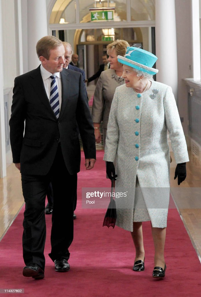 Queen Elizabeth II (R) and Prince Philip, Duke of Edinburgh (behind) meet Irish Prime Minister Enda Kenny (LL) and his wife Fionnuala Kenny (behind) during a visit to Government Buildings on Merrion Street on May 18, 2011 in Dublin, Ireland. The Duke and Queen's visit to Ireland is the first by a monarch since 1911. An unprecedented security operation is taking place with much of the centre of Dublin turning into a car free zone. Republican dissident groups have made it clear they are intent on disrupting proceedings.