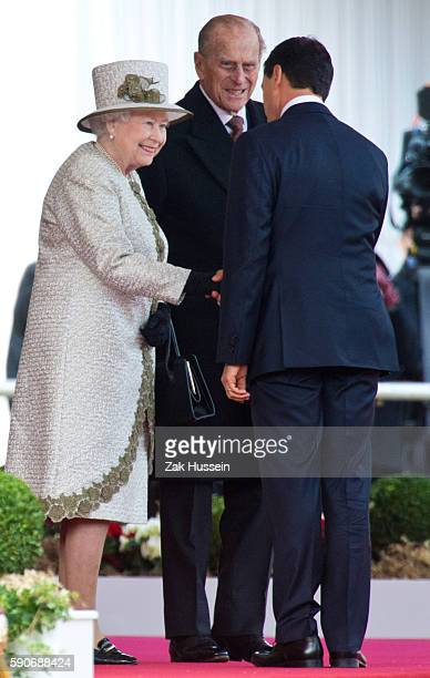 Queen Elizabeth II and Prince Philip Duke of Edinburgh meet Mexican President Enrique Pena Nieto during a ceremonial welcome for The President Of...