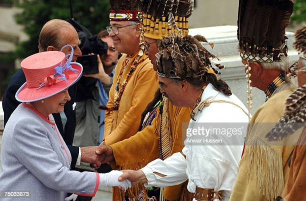 Queen Elizabeth II and Prince Philip Duke of Edinburgh meet Native American Indians on their arrival at the Capitol Building where the Queen made an...