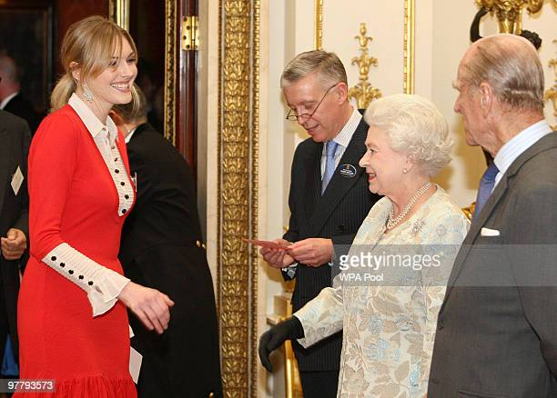 Queen Elizabeth II and Prince Philip Duke of Edinburgh meet Sophie Dahl at a reception for the British Clothing Industry including an exhibition of...