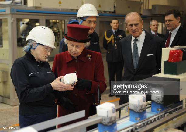 Queen Elizabeth II and Prince Philip Duke of Edinburgh meet Tate Lyle Packing Area Supervisor Teresa Croxford during a visit to the east London sugar...