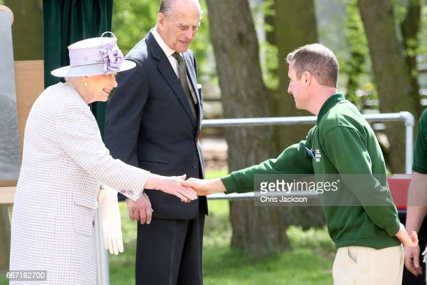 Queen Elizabeth II and Prince Philip Duke of Edinburgh meet the Head Elephant Keeper during their visit of the Elephant Centre at the ZSL Whipsnade...