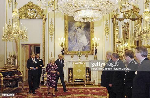 Queen Elizabeth II and Prince Philip Duke of Edinburgh meet the Home Secretary Charles Clarke the Mayor of London Ken Livingstone and the...