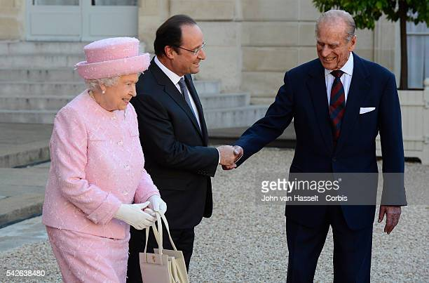Queen Elizabeth II and Prince Philip Duke of Edinburgh meet with President Francois Hollande of France at the Elysee Palace in Paris during the 70th...