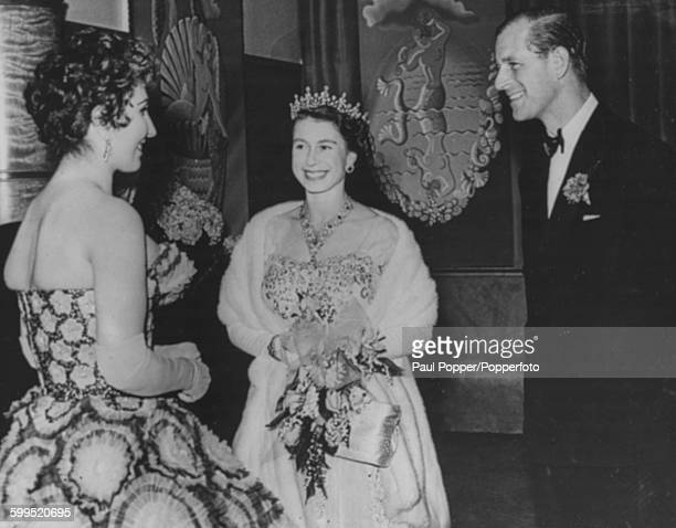 Queen Elizabeth II and Prince Philip Duke of Edinburgh meet with singer Alma Cogan following the Royal Variety Show Performance at the Opera House in...