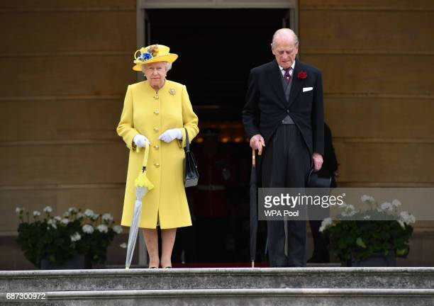 Queen Elizabeth II and Prince Philip Duke of Edinburgh observe a minute's silence in honour of the victims of the attack at Manchester Arena at the...