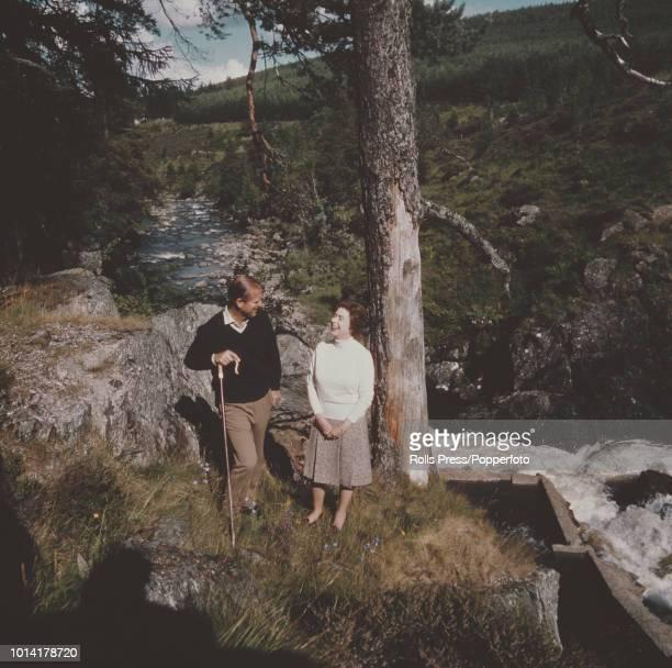 Queen Elizabeth II and Prince Philip, Duke of Edinburgh pictured together beside a stream or burn near Balmoral Castle, Braemar in Scotland during...