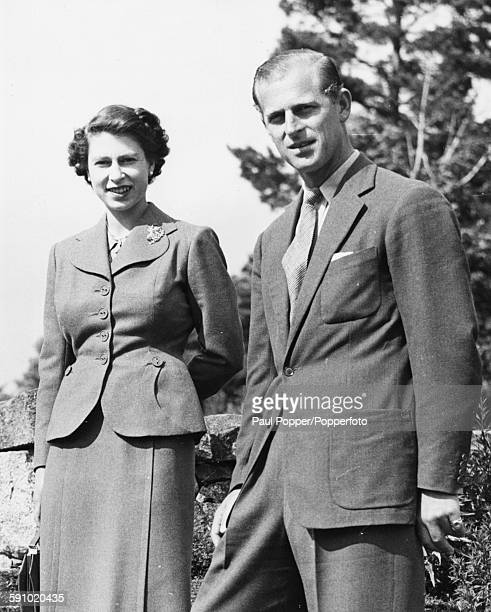 Queen Elizabeth II and Prince Philip Duke of Edinburgh pictured in the grounds of the royal estate of Balmoral Castle Scotland August 1953