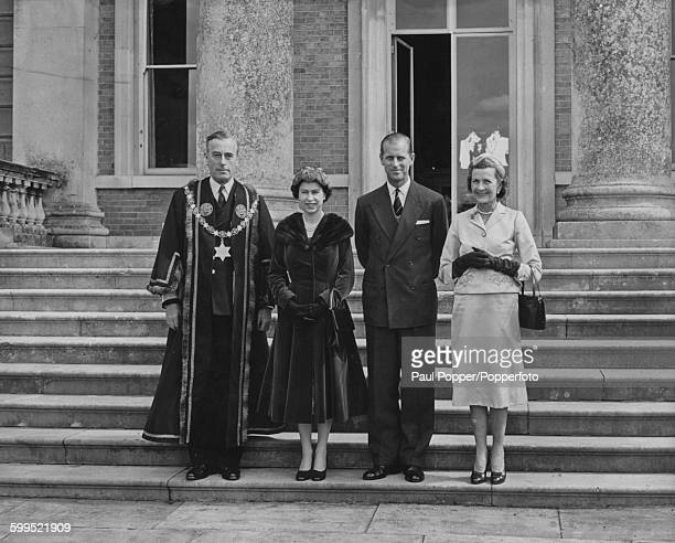 Queen Elizabeth II and Prince Philip Duke of Edinburgh pictured together on the steps of Broadlands with Louis Mountbatten 1st Earl Mountbatten of...