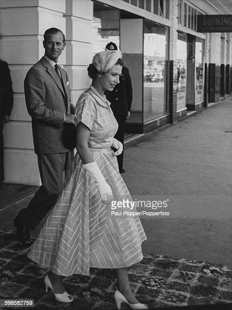 Queen Elizabeth II and Prince Philip Duke of Edinburgh pictured leaving the Masonic Hotel in Napier during the Royal Tour of New Zealand 6th January...