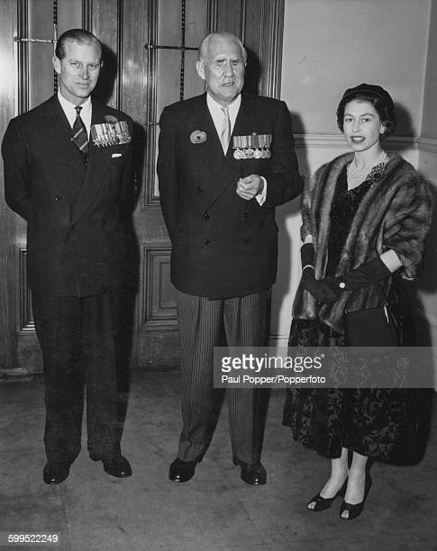 Queen Elizabeth II and Prince Philip Duke of Edinburgh pictured together with Sir Ian Fraser Baron Fraser of Lonsdale President of the British Legion...