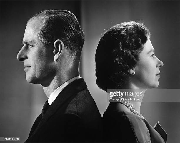 Queen Elizabeth II and Prince Philip, Duke of Edinburgh pose for a portrait, Buckingham Palace, London, December 1958.
