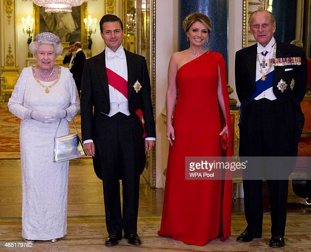 Queen Elizabeth II and Prince Philip Duke of Edinburgh pose for a photograph with Mexican President Enrique Pena Nieto and his wife Angelica Rivera...