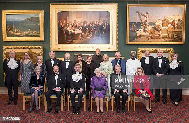 Queen Elizabeth II and Prince Philip Duke of Edinburgh pose for an official photograph during a reception for the High Commissioners' Banquet to mark...