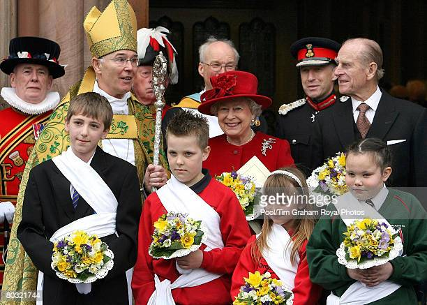 Queen Elizabeth II and Prince Philip Duke of Edinburgh pose for an offical photograph with Archbishop Alan Harper after the Maundy service at St...