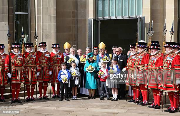 Queen Elizabeth II and Prince Philip Duke of Edinburgh pose with Yeomen and children as they leave Sheffield Cathedral after the traditional Royal...
