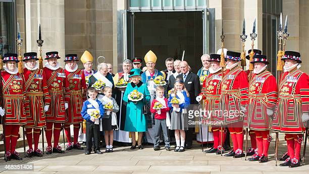 Queen Elizabeth II and Prince Philip Duke of Edinburgh pose with Yeomen and children as they attend the traditional Royal Maundy Service at Sheffield...