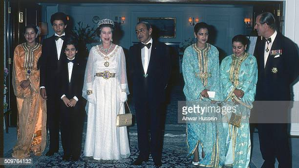 Queen Elizabeth II and Prince Philip Duke of Edinburgh pose with King Hassan ll and his family on board the Royal Yacht Britannia on October 30 1980...