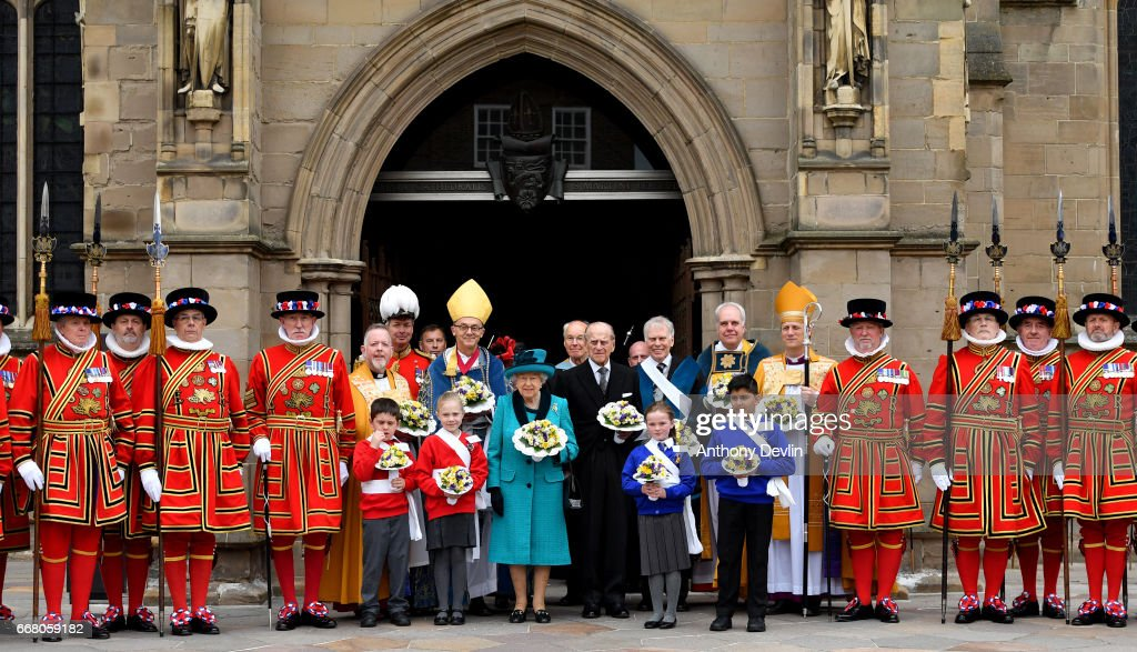 Queen Elizabeth II and Prince Philip, Duke of Edinburgh pose with Yeoman of the Guard following the Royal Maundy service at Leicester Cathedral on April 13, 2017 in Leicester, England. The Queen & Duke of Edinburgh travelled by car from Leicester station along Humberstone Gate, High Street and Jubilee Square.