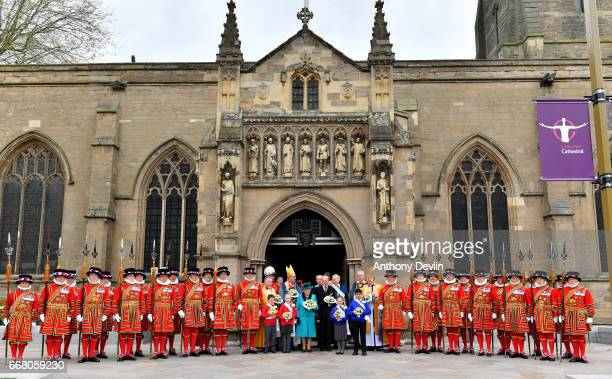 Queen Elizabeth II and Prince Philip Duke of Edinburgh pose with Yeoman of the Guard following the Royal Maundy service at Leicester Cathedral on...