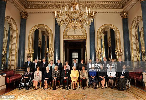Queen Elizabeth II and Prince Philip Duke of Edinburgh pose with Civil Service Commissioners before a reception for Civil Service Commissioners at...