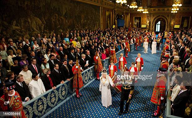 Queen Elizabeth II and Prince Philip Duke of Edinburgh proceed through the Royal Gallery in the Palace of Westminster during the State Opening of...
