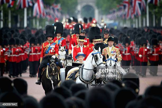 Queen Elizabeth II and Prince Philip Duke of Edinburgh process down the Mall during Trooping the Colour Queen Elizabeth II's Birthday Parade at The...