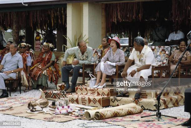 Queen Elizabeth II and Prince Philip Duke of Edinburgh receiving gifts while watching traditional dancers in Funafuti in Tuvalu on October 27 1982...
