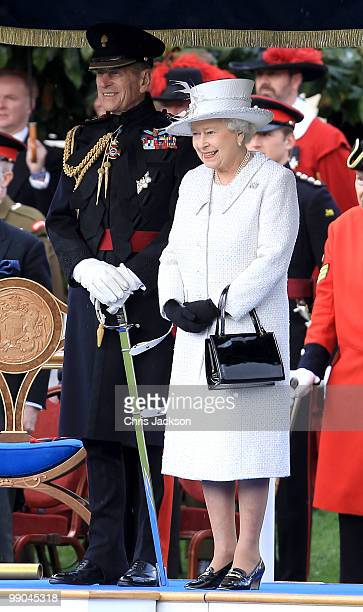 Queen Elizabeth II and Prince Philip Duke of Edinburgh review the Company of Pikemen and Musketeers at HAC Armoury House on May 12 2010 in London...